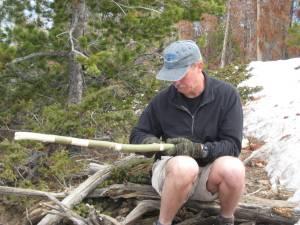 Tom H. carves his famed walking stick
